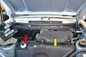 You're now looking at the fuse panel housing which is attached to the fire wall (red arrow) and the fuel expansion tank (yellow arrow); you do not need to remove the expansion tank to remove the firewall.