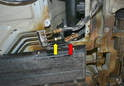You will need to use a 19mm wrench and hold the fitting on the line going to the tank (red arrow) while you use a 17mm wrench and disconnect the return line (yellow arrow).