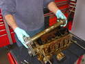 Remove the bolts that hold on the oil baffle/separator, and remove the guide for the main chain.