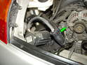Rotate the emissions pump over to reach the electrical connector (green arrow).