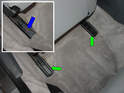 Move the seat forward as far as it will go to access the ends of each seat rail on the floor.