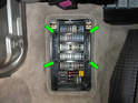 Remove the four Phillips head screws on the fusebox cover panel (green arrows).