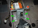 Now remove the four 10mm nuts holding the front center console support bracket to the center tunnel (green arrows).