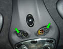 Remove the two Philips head screws from underneath (green arrows).