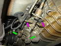 Remove the ball ends of the shift cables from the transmission by popping them off with a large screwdriver (green arrows).