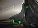 Remove the three screws (green arrows) that hold the lower rear quarter panel trim piece to the body.