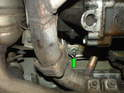 And also remove the 18mm nut on the left side of the engine (green arrow).