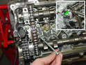 Carefully remove the leftmost camshaft-bearing caps on both of the camshafts (green arrow, inset photo).