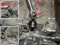 There are three externally accessible chain tensioners on the motor.