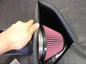 Next, fit the rubber hose around the lip of the air filter opening (it just pushes in around the edge).