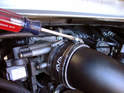 Once your V-Flow airbox is completely assembled, in one step, install the unit the same way you uninstalled the OEM airbox (slide the oil filler tube aside to give you room).