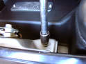 Taking your OEM airbox bolt, fit it through the L-bracket and chassis hole.