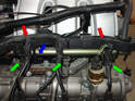 On the right side of the engine remove the wiring harness duct from the fuel rail by simply pulling it up.