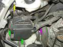 Begin by removing the hose going to the emissions pump at the left of the engine compartment (996 only).