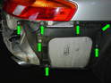 6: Remove the 10mm nuts holding each exhaust shield over the mufflers on each side of the car and take the exhaust shields off.