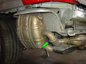 7: Shown here is the muffler attached to the car with the heat shields removed.