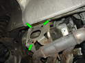 9: Here is the bracket that attaches the muffler to the side of the car.