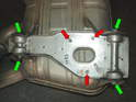 11: Shown here is the bracket that attaches directly to the muffler.