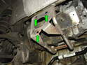 Now loosen the 19mm clamp that holds each catalytic converter to the car (green arrow) You'll probably have to pry the clamp open slightly to get it over the lip of the mounting plate (purple arrow) At this point, lower the catalytic converters off the car.