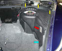 The master cylinder is hidden behind a plastic panel located in the front trunk.