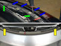 With the front black plastic cover piece removed, you can see the two screws that hold the front bumper cover on to the chassis of the 996 (lower image).