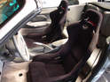 This photo shows a set of after market carbon fiber seats being installed in a 996 Cabriolet.