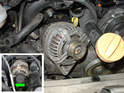Rotate the alternator to remove it from the engine.