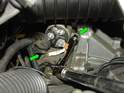 As with the electrical connections, you'll need to find the right combination of u-joints and extensions to reach the two 15mm bolts on either side of the starter motor (green arrows).