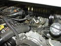 Once both bolts are removed, carefully remove the starter from under the intake plenum and out from the engine.