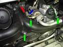 There are three 10mm bolts (green arrows) holding the boost manifold in place.