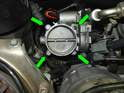 Remove the four 10mm bolts (green arrows) holding the throttle body to the intake plenum, and pull the throttle body out of the engine compartment.