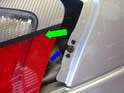 Slide the taillight assembly back (green arrow) off of the fender stud (blue arrow).
