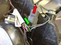 Now depress the locking lever (green arrow) on the electrical connector, and pull the vehicle harness (red arrow) out of the taillight connector.