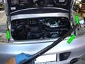 Carefully remove the metal trim strip from the bumper paying close attention to the ends, making sure you don't scratch the trim piece on the taillight brackets (green arrows).