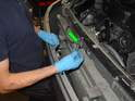 Now pull the bumper back away from the car, and detach the license plate light electrical connector (green arrow) by pressing the release tab and separating the two halves.