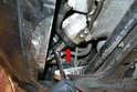 Using a 36mm wrench or socket, loosen and remove the housing cap (red arrow).