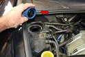 Open the cap on the coolant reservoir (red arrow) to break the vacuum in the coolant system.