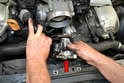 If you remove the pump from the engine bay by turning it in the opposite direction that it mounts, you can remove the old one and install the new one without removing any lines on the front of the motor (red arrow).