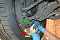 Perform the same inspection for the lower ball joint (green arrow) as you do on the upper.