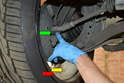 Perform the same procedure for the outer tie rod ball joint (green arrow).