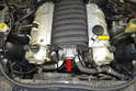 When you remove the engine covers it will include removal of the AOS (air oil separator) hose (yellow arrow).