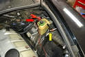Attach the leads from the Smoke Pro to the jump post (red arrow) and the ground (yellow arrow) in the rear left side of the engine bay.