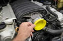 Use the provided plastic cups to plug the throttle body.