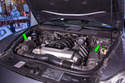 Shown here are the locations of the two air filters on the Porsche Cayenne (green arrows).