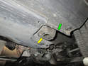Shown here are the jacking point locations just behind the front wheel on a Cayenne.