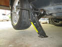 As before, here is aPicture of the factory supplied jack lifting the rear of the Cayenne.
