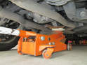 As before, place cardboard or rolled up newspaper in between the floor jack and the subframe.