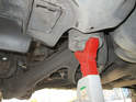 Here is the jack stand supporting the car under the rear jack point.