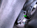 Shown here is the idler pulley on the left side of the engine (green arrow), just next to the crankshaft pulley.