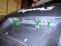 Shown here are the license plate light holders on the rear hatch.